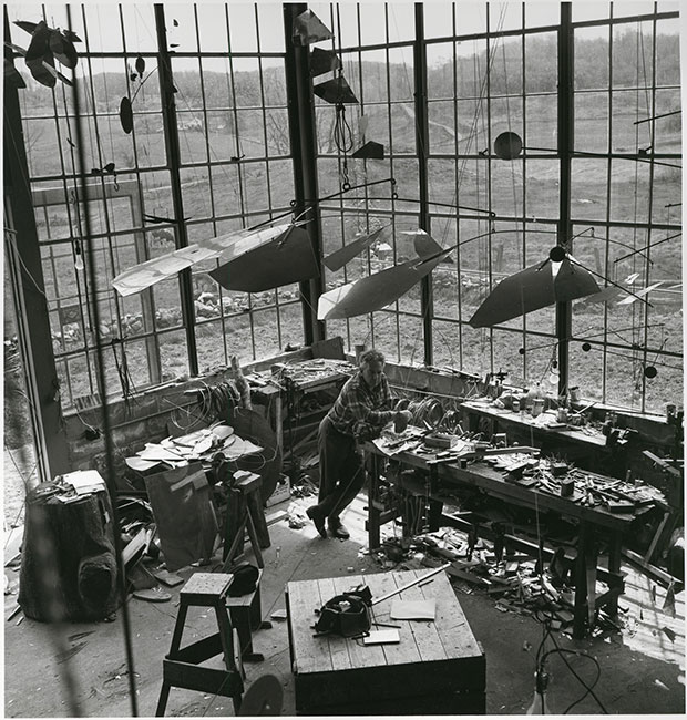 Calder-with-Mobile Connecticut studio 1941
