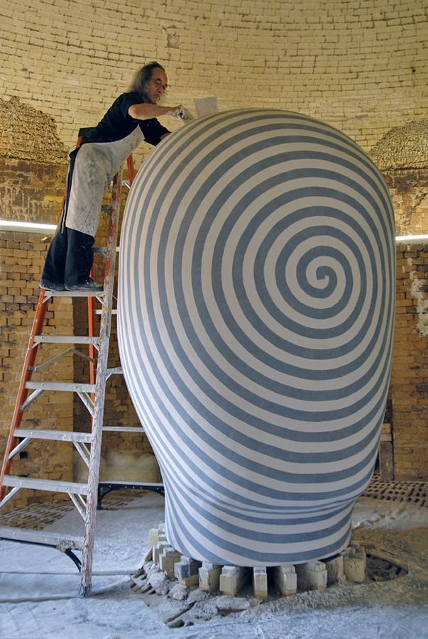 "Jun Kaneko in his Omaha, Nebraska studio/kiln, working on one of his massive dango (""dumpling"") ceramic pieces."