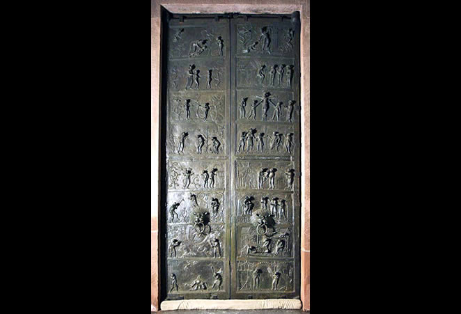 "Doors with relief panels (Genesis, left door; life of Christ, right door), commissioned by Bishop Bernward for Saint Michael's, Hildsheim, Germany, 1015. 16'6"" high. Dom-Museum, Hildsheim"