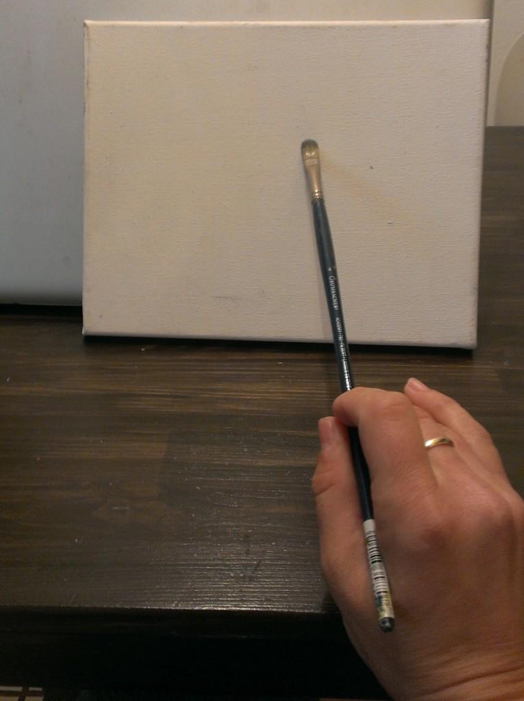 holding paintbrush 1