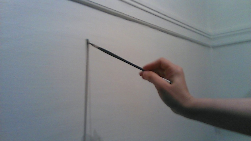 holding paintbrush 11