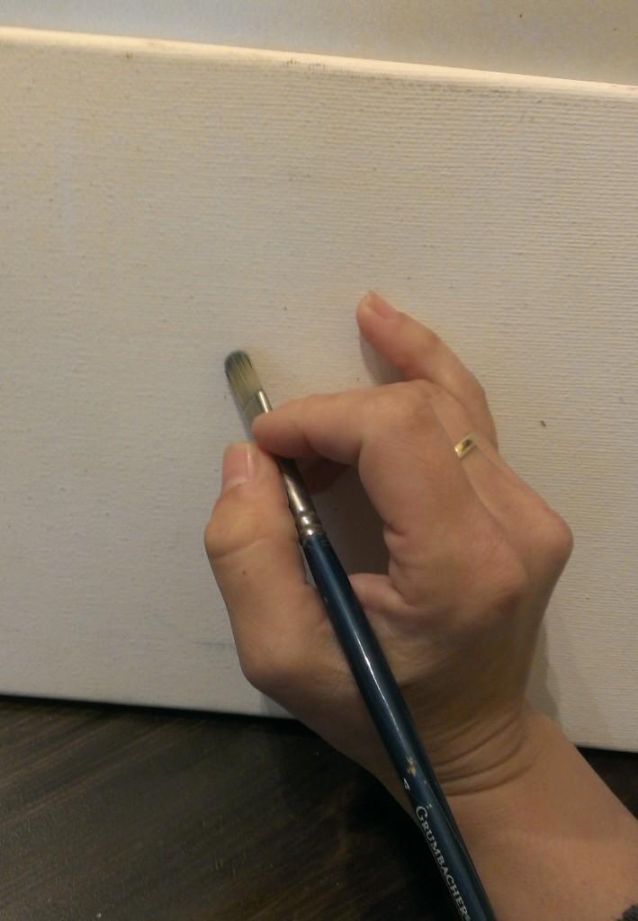 holding paintbrush 6