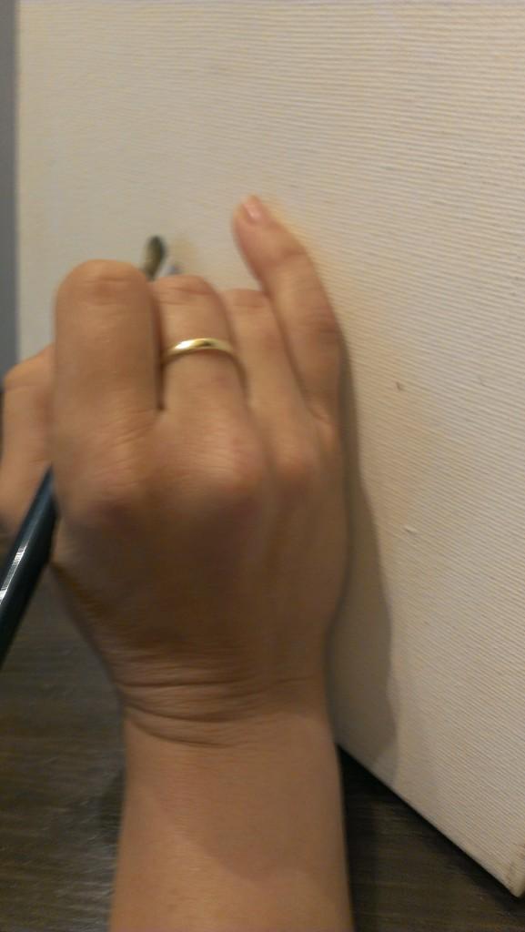 holding paintbrush 7